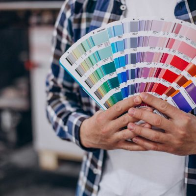 man-working-printing-house-with-paper-paints